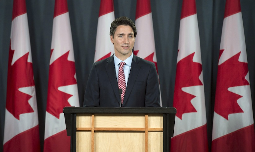 Prime minister-designate Justin Trudeau attends his first official news conference at the National Press Theatre in Ottawa, Tuesday Oct.20, 2015. THE CANADIAN PRESS/Adrian Wyld